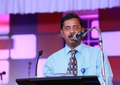 Addressing a gathering of learning community